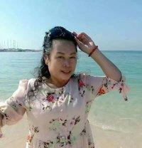 Huang Waiwai - escort in Al Manama