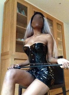 Lucrecia - dominatrix in Madrid Photo 3 of 3