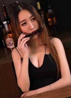 Lucy - escort in Beijing Photo 2 of 5