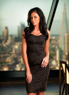 Megan - escort in Singapore Photo 3 of 3