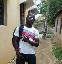 Pharis Omanye - Male adult performer in Mombasa