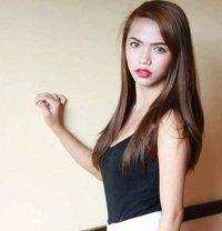 Red - escort in Manila