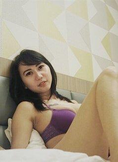 Tikaa - Transsexual escort in Jakarta Photo 1 of 5